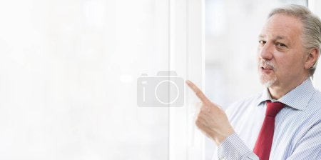 Businessman point to large bright copy-space