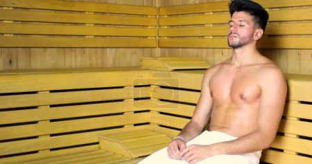 Photo for Man relaxing in a sauna, eyes closed - Royalty Free Image