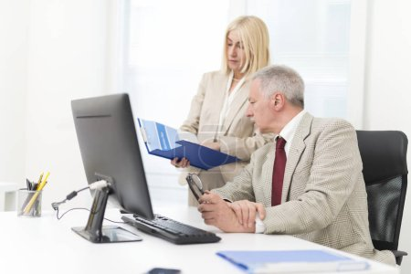 Photo for Business people at work in their office - Royalty Free Image