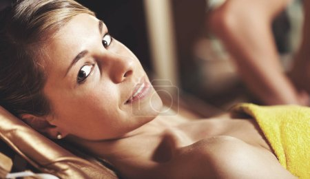 Portrait of a beautiful woman relaxing in a spa