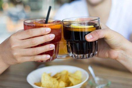 Closeup of friends toasting glasses