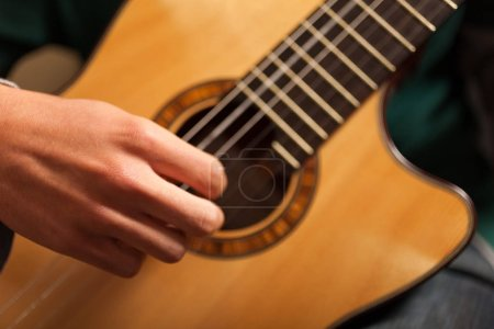 Photo for Detail of a classical guitar player with guitar - Royalty Free Image