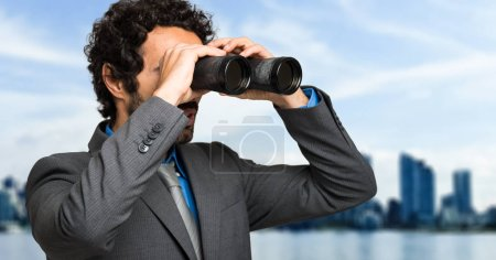 Photo for Businessman looking through binoculars - Royalty Free Image