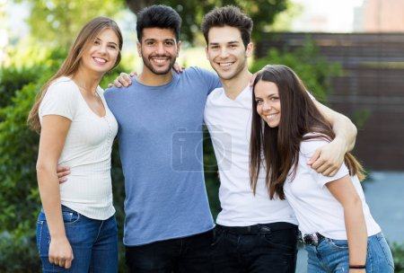Photo for Outdoor portrait of a group of friends hugging - Royalty Free Image
