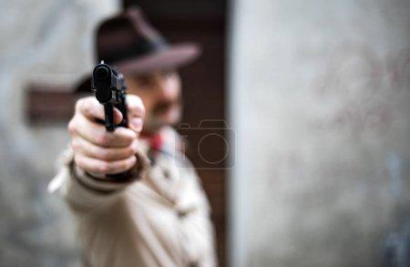 Hitman pointing the gun to the camera...