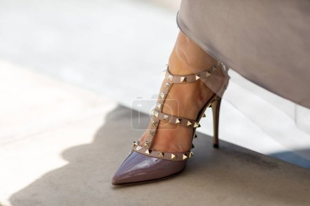Close-up of young woman's legs in high-heeled shoe
