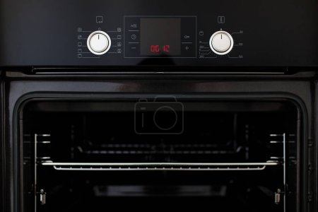 Electric oven built into kitchen furniture