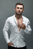 Closeup photo of athletic guy in white shirt . Muscular body.