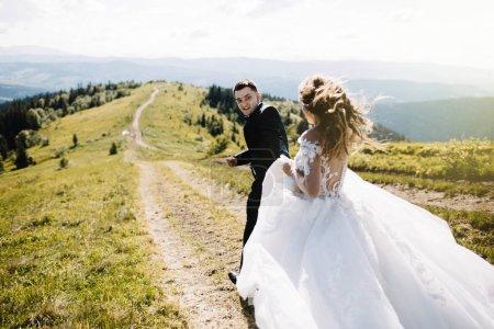 Wedding couple. Beautiful wedding couple in the mountains.