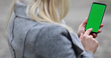 Photo for Close-up of female hands using smart phone. woman typing text message on her cellphone. - Royalty Free Image