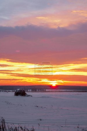 Majestic sunset in the winter landscape. Fantastic morning landscape glowing by sunlight. Dramatic wintry scene. Natural park.