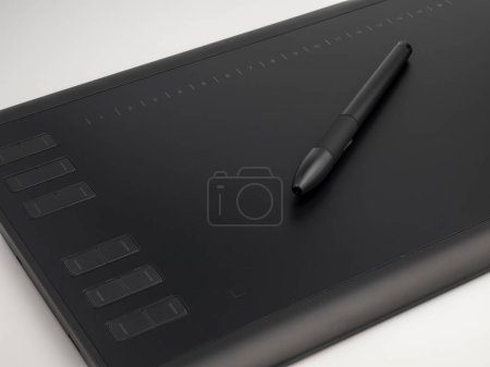 Graphic tablet with pen for illustrators and designers, on white background