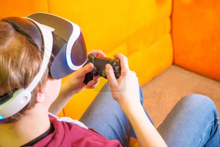Photo for Set of Young man teenager virtual reality headset or 3d glasses, playing video game. Human reaction facial expression emotion concept. Play on controller console TV. - Royalty Free Image