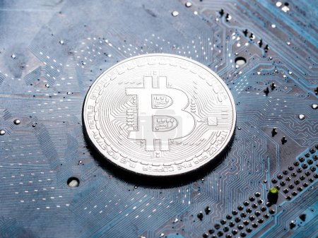 Photo for Silver bitcoins on circuit board.  The concept of the mining of crypto-currency. - Royalty Free Image