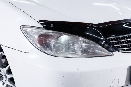 Photo for Novosibirsk, Russia  July 08, 2019:  Toyota Camry, close-up of the headlight, bumper, wheel. Photography of a modern car on a parking in Novosibirsk - Royalty Free Image