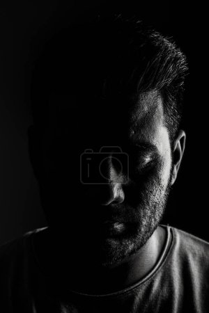 Photo for Indian man low key black and white portrait. High contrast dramatic look. - Royalty Free Image