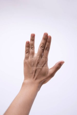 Photo for Closeup of persons hand showing gesture over white background - Royalty Free Image