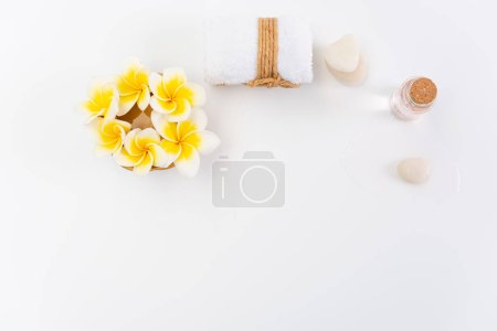 Spa concept,white towels,rose liquid soap,Plumeria flower and ze