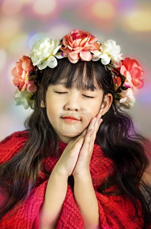 Photo for Cute asian little girl with wreath of flowers on her head - Royalty Free Image