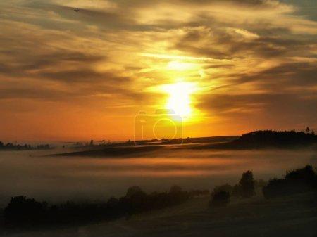 landscape with fog and beautiful sunrise