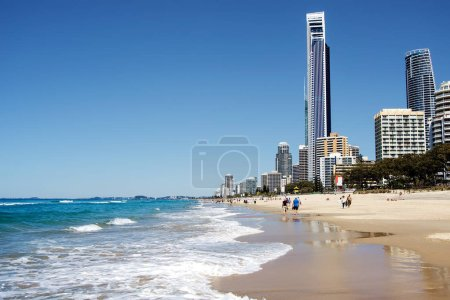 Sunny day at the beach with modern city buildings on background, Gold Coast, Australia