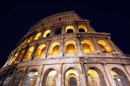 Night view of amazing Colosseum in Rome, Italy