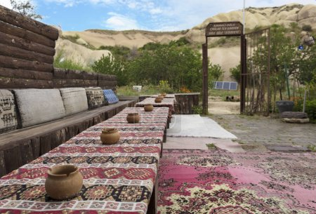The hospitable view of the old cafe of a high-rise Turkish courtyard in Cappadocia