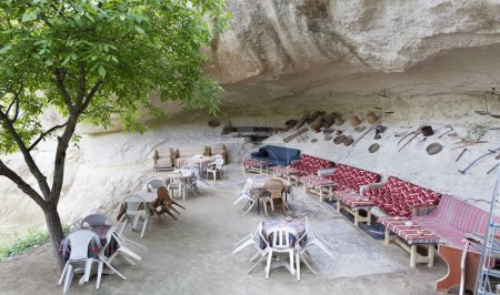 A welcoming view of an old cafe in a high-rise Turkish courtyard in Cappadocia