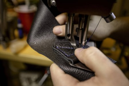 Photo for Starting to create a box stitch pattern on black leather - Royalty Free Image