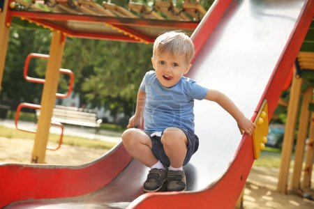 Photo for Cute little boy on children's playground - Royalty Free Image
