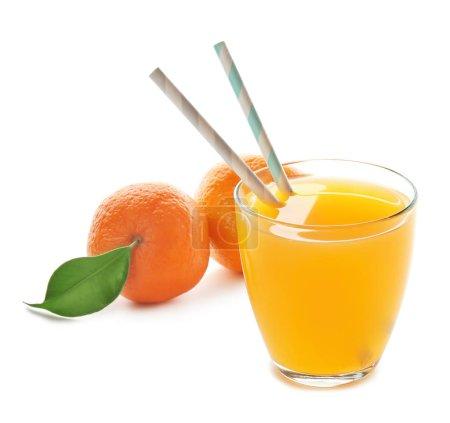 Glass of tangerine juice and fresh fruit on white background