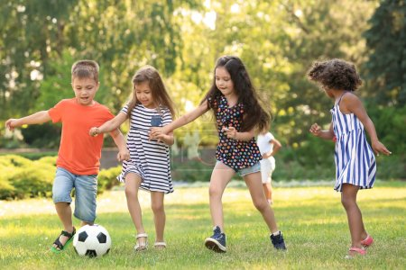 Photo for Cute little children playing football outdoors - Royalty Free Image