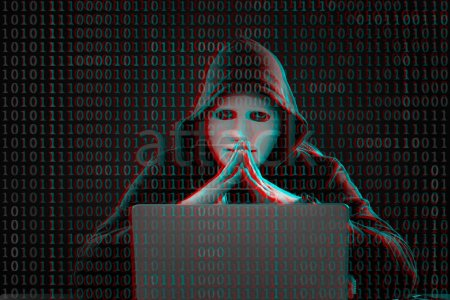 Hacker with mask, laptop and binary code on dark background