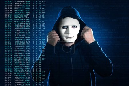 Hacker with mask and code on dark background