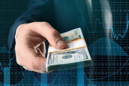 Double exposure of graphs and financial trader with money. Forex concept