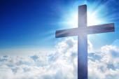 Wooden cross on sky background. Christian religion