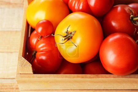 Photo for Different tomatoes in wooden box, close up - Royalty Free Image