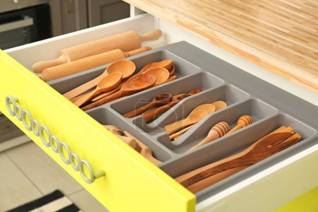 Photo for Wooden kitchen utensils in drawer indoors - Royalty Free Image