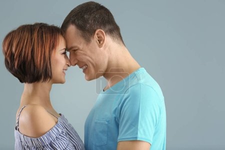 Photo for Portrait of cute loving couple on color background - Royalty Free Image