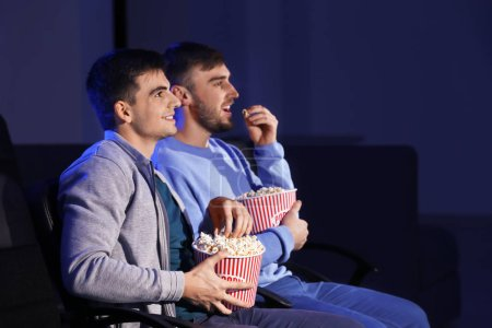 Young men watching movie in cinema