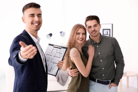 Real estate agent with clients in new house