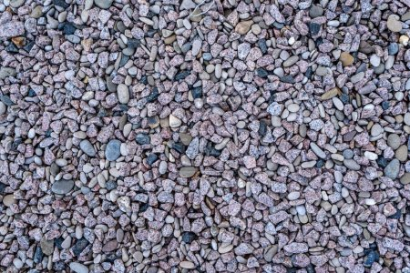 Stones background or texture, copy space. Granite gravel or crushed stones background with copy space