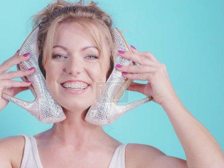 Teenage woman fashion stylist presenting her elega...