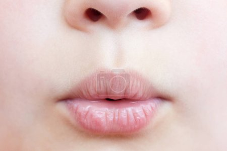 Lips of little child, close-up view