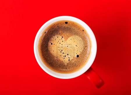 cup of fragrant coffee on red background for your design