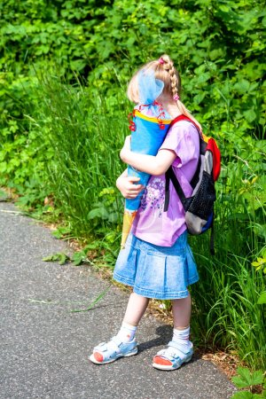 Photo for Little girl on her way to her first day of school. - Royalty Free Image