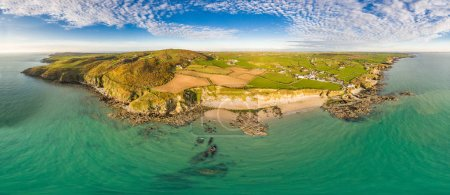 Photo for Aerial view of Church Bay in Anglesey North Wales UK during sunset. - Royalty Free Image