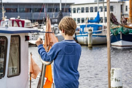 Boy enjoying his family vacation in the harbour