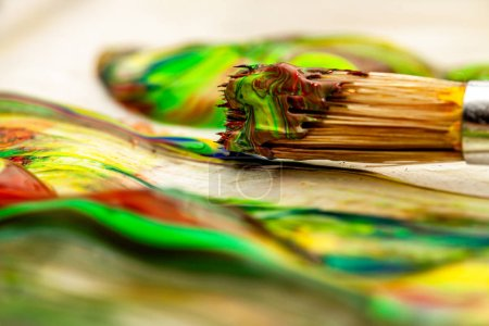 Photo for Close up of liquid artist colours on brush and pot. - Royalty Free Image