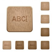 Typing text with cursor on rounded square carved wooden button styles